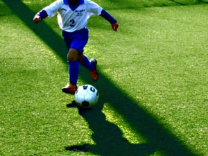 boy-playing-soccer