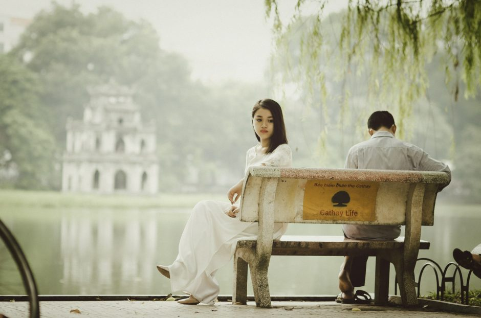 a couple sitting on the bench