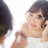 Beautiful young asian woman applying makeup eyebrows brush, beau